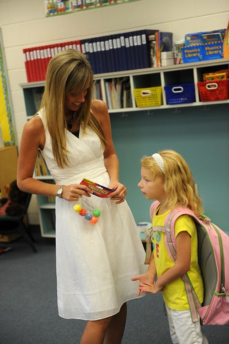 visiting her kindergarten teacher