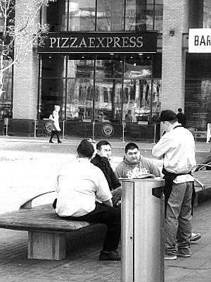 a group of chefs having a ciggie break from a nearby restaurant (not the Pizza Express!).