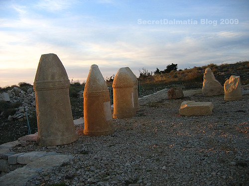 Traditional Illyrian cipus tombstones.