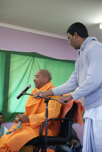 Koti prabhu adjusts the microphone