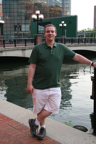 Sean with Aquarium behind him