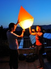 Sending a traditional flying lantern off on a perfect evening in Austria!