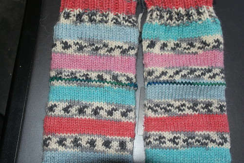 The blue/green lines are the waste yarn for the afterthought heels