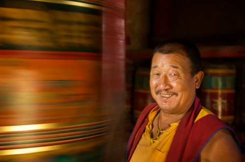 Spinning prayer wheels and a friendly Tibetan monk in Dawu, Tibet (China).