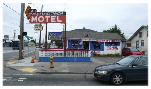 Motel sign and Bible-thumping vacuum cleaner store, Seattle.