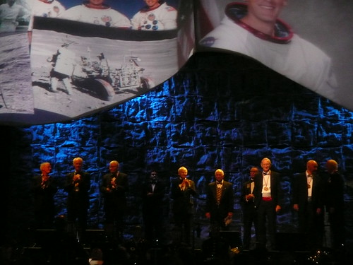 Astronauts on the Stage. Left to right: Glynn Lunney, Rusty Schweickart, Fred Haise, Alan Bean, Bill Anders, Walt Cunningham, Charlie Duke, Jim McDivitt, Al Worden
