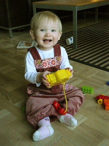 Playing - in her new overalls
