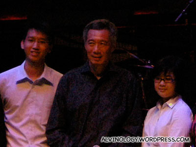 Close-up of PM Lee and two students who volunteered to go on stage