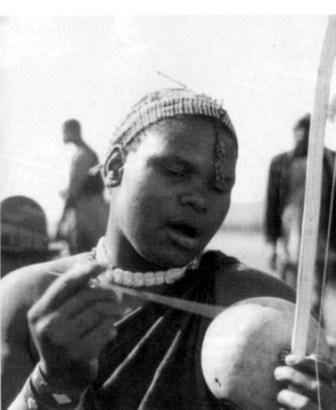 the nquni woman playing the bow copy