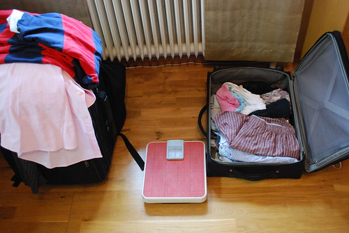 Preparing for the next trip - with the scales for weighing the luggage