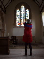 Pippa Martin photographing Lawrence Lees window at St James Church, Abinger