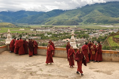 Monks gather before lunch on a balcony overlooking Ganze, Tibet (China).