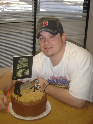 Heres Matt with his Star Wars-inspired cake. I wrote a little poem about Han Solo Anderson and Stace fashioned it to look like the movies opening credits.