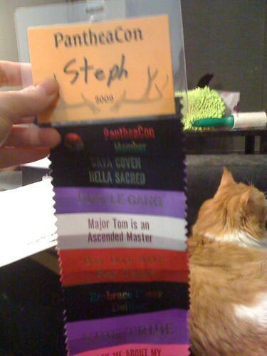PantheaCon badge and ribbons