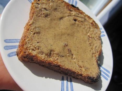 Cinnamon Raisin Ezekiel with Almond Butter