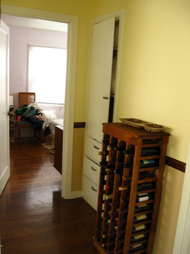 the hallway doubles as our wine cellar