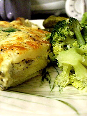 Fritatta, served with broccoli and pickled gherkins