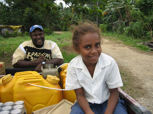 Our chartered pick-up with driver Chief Joseph and his grand-daughter plus our jerry cans and supplies (Oyster Island)