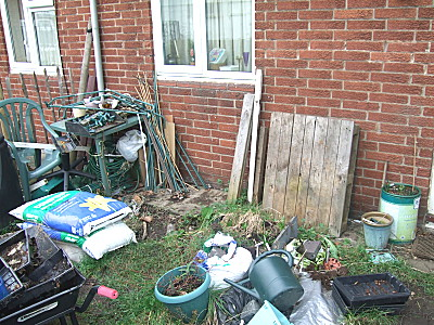 during - having pulled most of the stuff out (except under the table, i aint going under there, no siree! i found enough snails, slugs and bugs as it was..) it was a case of sorting things out...