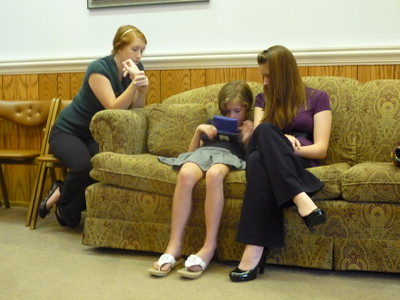 Essie playing DS at the funeral home with cousins.