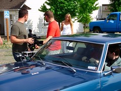 Attaching a camera to a car in a complex attempt to accurately capture what the asshole writer put in the script without thinking how hard it would be to get the shot.