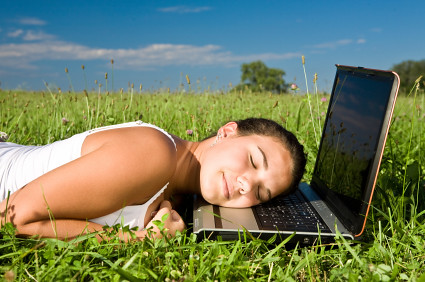 young beautiful girl sleep on laptop outdoor