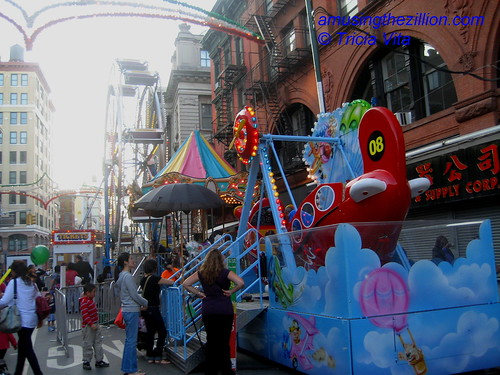 Carnival Rides on Grand Street. Photo © Tricia Vita/me-myself-i via flickr