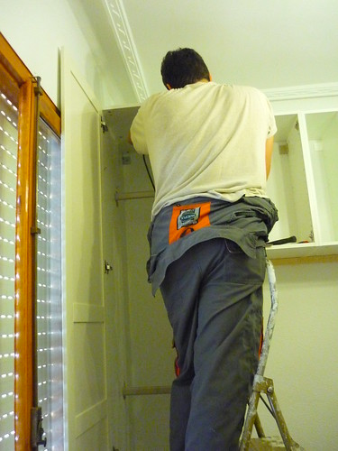 The handyman putting up wardrobes
