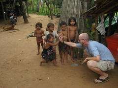 High fives with the local kids in a village outside the flooded forest