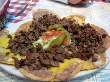 nuevo laredo cantina - le plate of beef fajita nachos (aka nachos asada)
