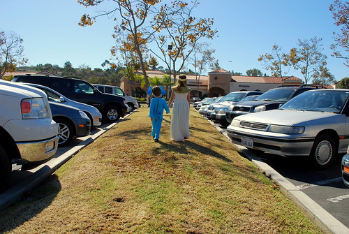 siblings in a parking lot