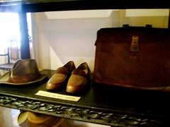 A hat, a pair of shoes and a leather bag
