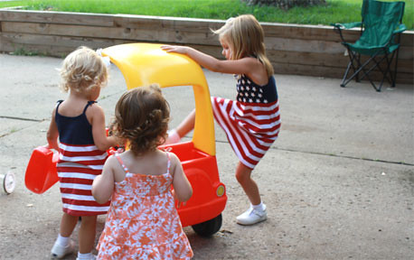 Adrianna, Skyler, and Olivia, playing in the driveway before fireworks