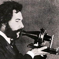 1876_bell_speaking_into_first-phone copy