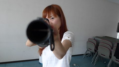 Zhu Dan aiming her shotgun