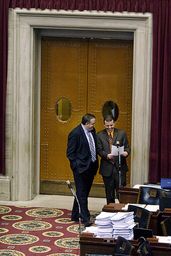 Minority Floor Leader Paul LeVota and Majority Floor Leader Steven Tilley share a fun moment in the rear of the House chamber.