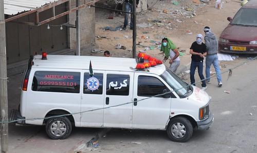 Qalandiya Rioters Use Ambulance for Cover While Hurling Rocks