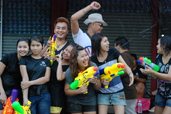 70 - Even a group photo degenerates into a water fight at the Chatuchak weekend market during Songkran in Bangkok