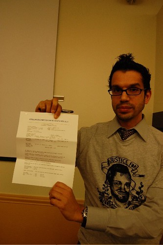 Lawyer Yavar Hameed holds up an airline ticket for Canadian Abousfian Abdelrazik, stranded in Sudan since 2003.