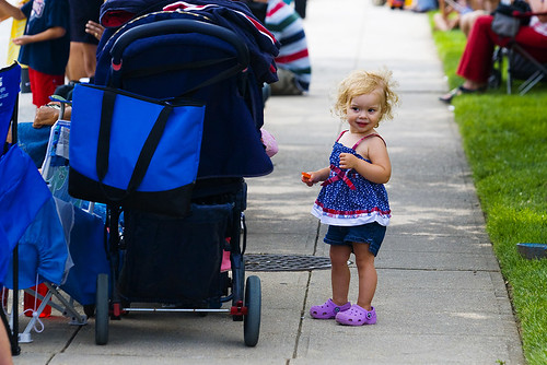 Two-year-old Grace Brusky of Silver Spring watches Takoma Parks 120th annual Independence Day parade on July 4, 2009.
