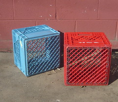 red and blue milk crates, maroon wall