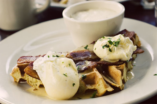 Eggs Benedict w/ bacon and waffles