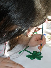 Sophia Painting Her Potato Print Shamrock