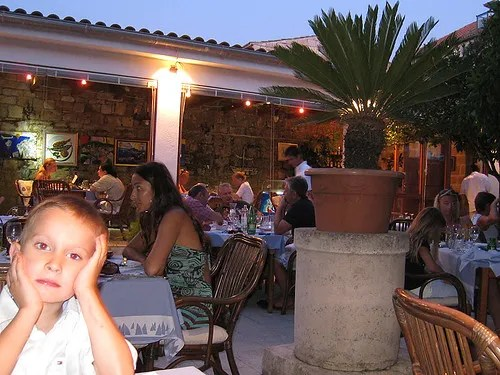 My son waiting for the food in Pojoda garden