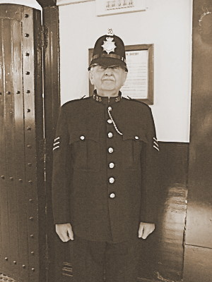 An Ex-policeofficer, modelling a uniform from around the turn of the century to the 1950s. He said when he first joined the force, in the 1950s, he wouldve worn a very similar uniform - in fact, the chain stretching from the top button to the pocket is his own: it goes to a whistle. We had a lovely long chat about policing, how it was then compared to how it seems to be now. A proper gentleman.