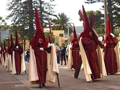 Some brotherhoods drag full sized wooden crosses