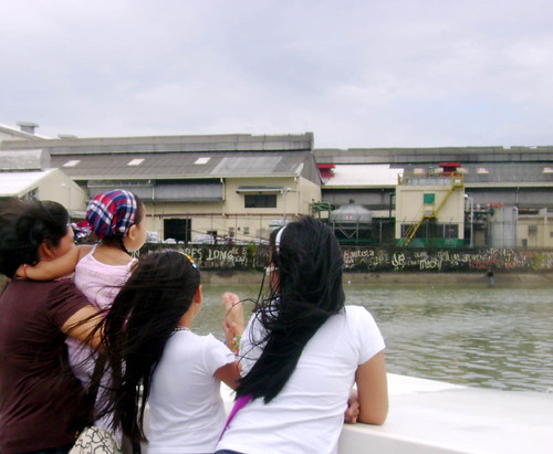 A Family on deck observing the Pandacan oil depo