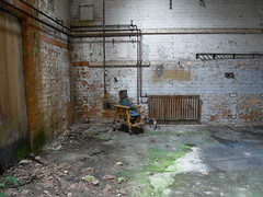 Abandoned. Child's chair. Asylum.