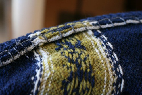 Facings tacked down with blanket stitch