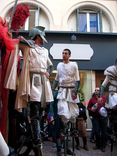 Spartans on springy stilts in the parade.